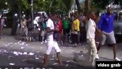Activistas de UNPACU y Todos Unidos protestan en la calle Reina, en La Habana.
