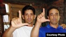 Yordan Mariño (izquierda), junto al Coordinador Nacional del MCL, Dr. Eduardo Cardet. Cortesía, MCL.