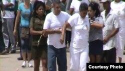 Damas de Blanco en Colón al salir de misa domingo 4 de agosto.