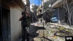Soldados sirios durante un patrullaje en un área de Damasco (Siria) en noviembre de 2012,