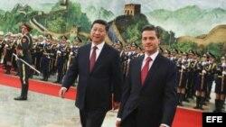 Los presidentes de México, Enrique Peña Nieto y de China, Xi Jinping, en Pekín.