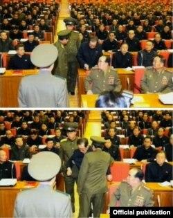 Jang Sung Taek es levantado de su silla en una reunión del partico gobernante norcoreano y arrestado por dos guardias.,