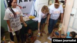 Reporta Cuba. Activistas de FLAMUR trabajando en el proyecto La Edad de Oro.