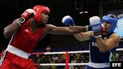 Robert Alfonso (i), se enfrenta al brasileño Antonio Nogueira, por las semifinales de la categoría +91 kg, en el marco de los Juegos Panamericanos Río de Janeiro 2007.
