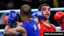 Roniel Iglesias (azul) derrotó a Vladimir Margaryan (rojo).