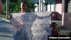 Reporta Cuba. Esposa e hijo de Yeri Curbelo. Foto: Cortesía ADO.