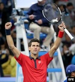 Djokovic celebra su victoria frente a Ferrer.