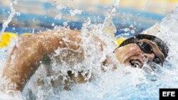 BAR429 LONDRES (REINO UNIDO) 28/07/2012.- El nadador estadounidense Ryan Lochte en acción durante la final de los 400m estilos de los Juegos Olímpicos Londres 2012, en el Centro Acuático de Londres, Reino Unido, hoy sábado 28 de julio de 2012. EFE/BARBARA