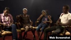 Dama de Blanco Yurleany Tamayo (izq) junto a sus dos hijas y esposo. You Tube Estado de Sats