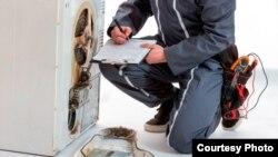 Anuncio de un negocio legitimo de reparación de lavadoras y neveras en Tenerife.Canarias.