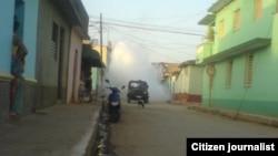 Reporta Cuba. Carros en Trinidad en labores de saneamiento. Foto: Maidín Carretero.
