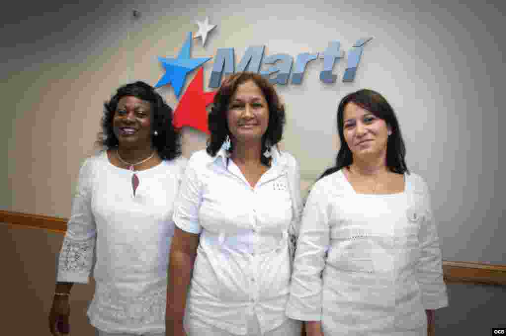Ladies in White Berta Soler, Belkis Cantillo and Laura Maria Labrada stand in front of the Martí sign during their visit to OCB