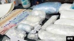 Droga, dinero y otros efectos intervenidos a la red de distribución de cocaína a gran escala liderada por un grupo de colombianos que introducía la sustancia en España. EFE/Javier Cebollada