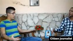 Reporta Cuba. Ernesto Oliva (i) entrevistado por Ernesto Vera (d).