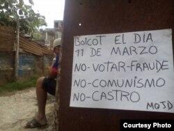 En Santa Clara el MOJD distribuye pancartas pidiendo a la población no votar