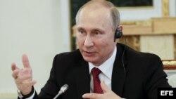 El presidente ruso, Vladímir Putin, durante su entrevista con los presidentes de 10 grandes agencias de prensa internacionales.