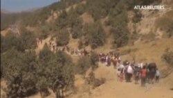 Familias enteras de yazidíes siguen huyendo de las matanzas del Estado Islámico en Irak